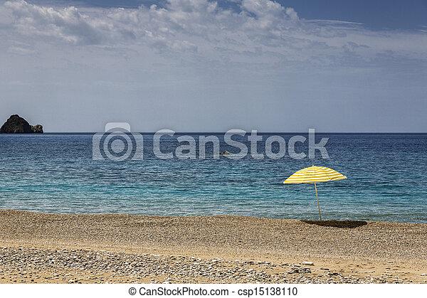 Sun umbrella on Paradise Beach on Corfu island, Greece