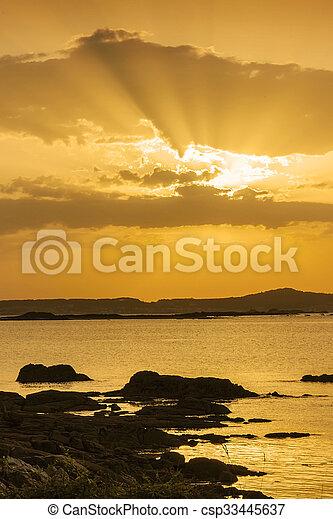 Sunbeams on the coast - csp33445637