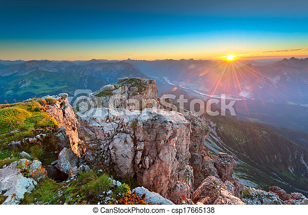 sunbeams while sunset in rocky tyrol mountains austria - csp17665138
