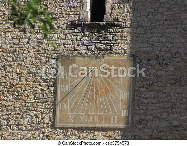 Sundial, sun, church, village - csp3754573