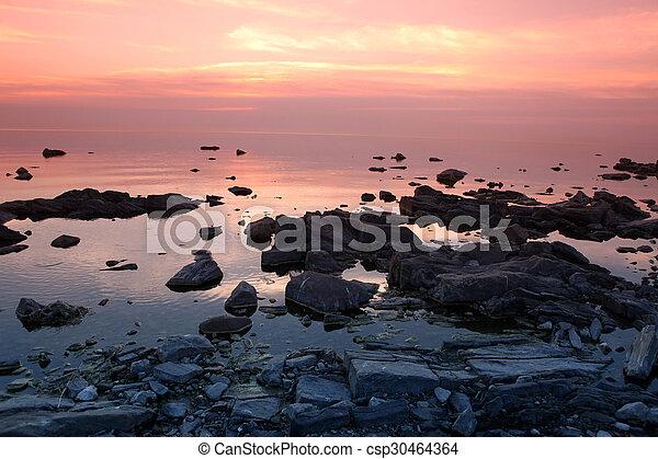 Sundown at Rock coast, Lake Baikal, Russia - csp30464364