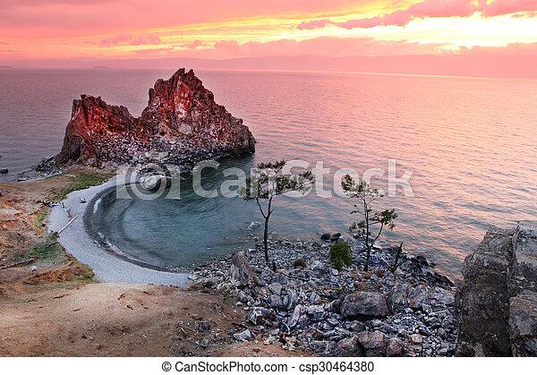 Sundown at Shaman Rock, Lake Baikal, Russia - csp30464380