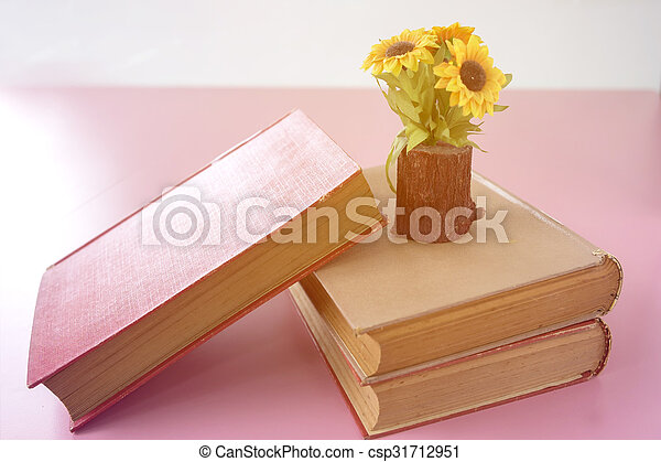 Sunflower and books on the table - csp31712951