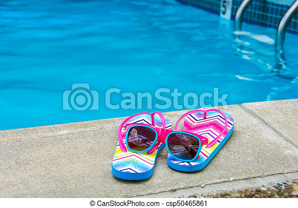 8b76f9f9 Sunglasses and flip-flops by pool. Sunglasses on flip-flops by edge ...