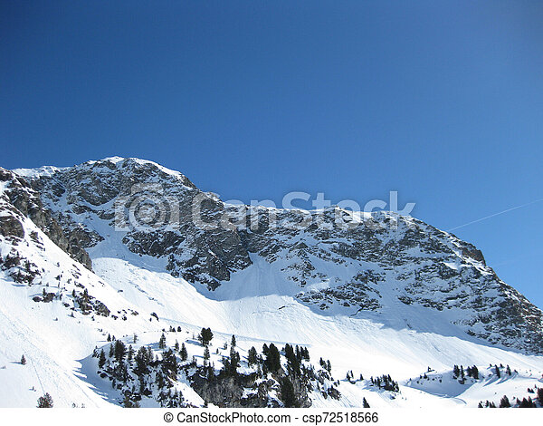sunlit mountains on a sunny winter day - csp72518566