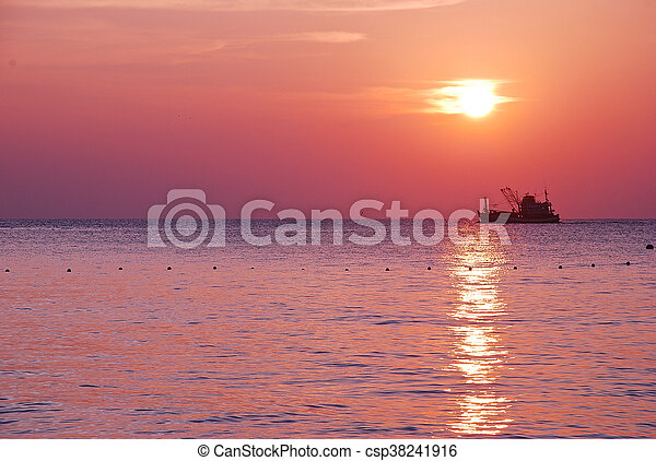 sunrise and boat on sea in the morning - csp38241916