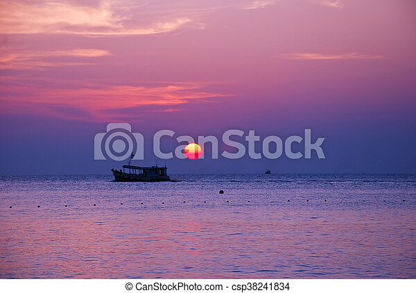 sunrise and boat on sea in the morning - csp38241834