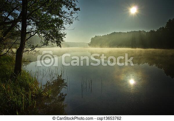 Sunrise at foggy lake in autumn - csp13653762
