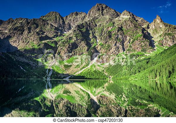 Sunrise at lake in the Tatra Mountains, Poland, Europe - csp47203130