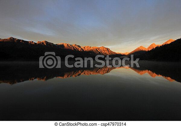 Sunrise at Lake Totoral in autumn, Argentina - csp47970314