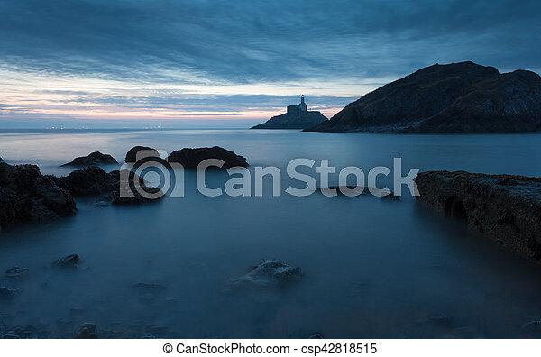 Sunrise at Mumbles lighthouse - csp42818515