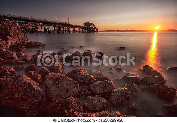 Sunrise at Mumbles pier - csp50299950