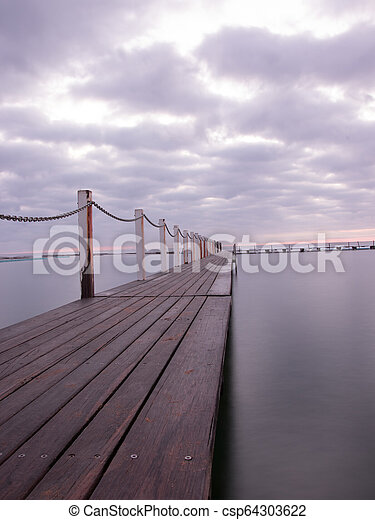 Sunrise at Narrabeen Pools, Northern Beaches of Sydney. - csp64303622