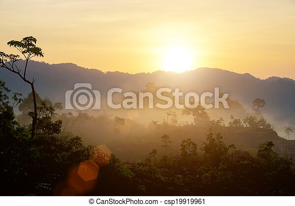 Sunrise at the fog mountains in the summer. - csp19919961
