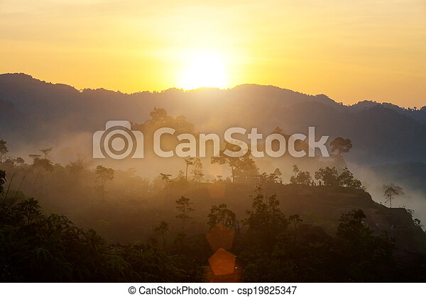 Sunrise at the fog mountains in the summer. - csp19825347