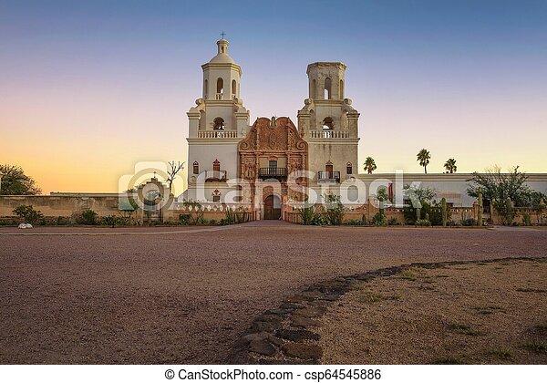 Sunrise at the San Xavier Mission Church in Tucson - csp64545886