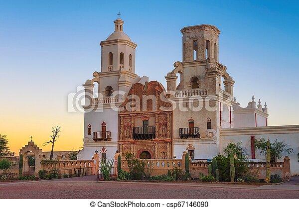 Sunrise at the San Xavier Mission Church in Tucson - csp67146090