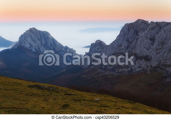 Sunrise at Urkiola over a foggy valley - csp43206529
