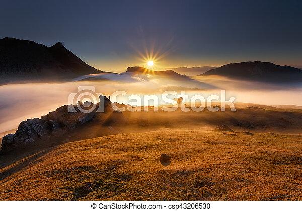 Sunrise at Urkiola over a foggy valley - csp43206530
