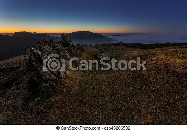 Sunrise at Urkiola over a foggy valley - csp43206532