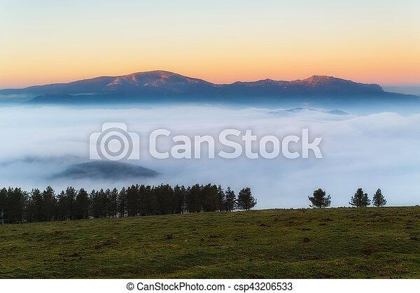 Sunrise at Urkiola over a foggy valley - csp43206533