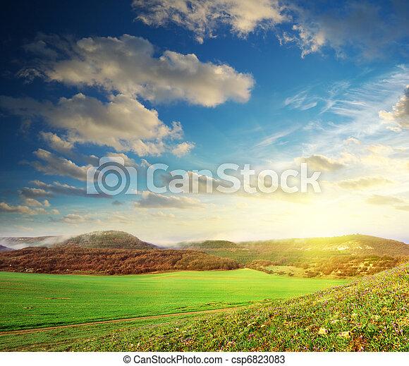 Sunrise in green meadow - csp6823083