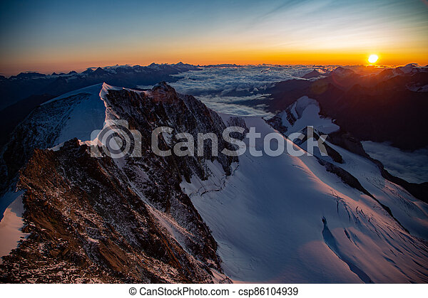 Sunrise in the mountains - csp86104939