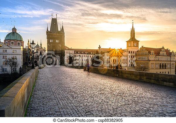 Sunrise on Charles Bridge in Prague - csp88382905