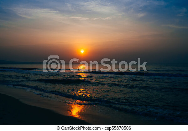 sunrise on the background of blue sky at sea - csp55870506