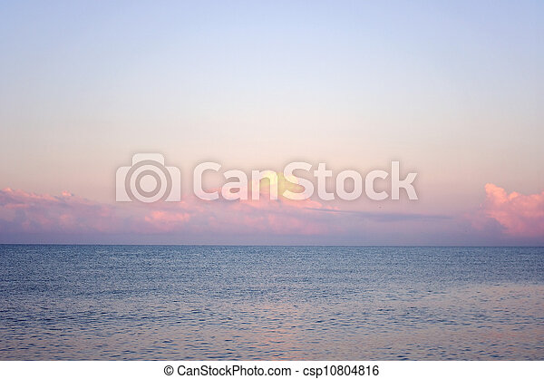 Sunrise on the sea in calm weather - csp10804816