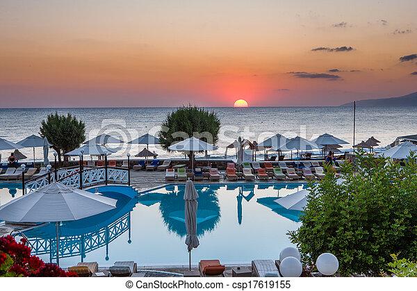 Sunrise over a tranquil tropical coastal resort - csp17619155