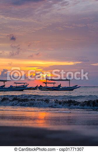 sunrise over fishing boats on Bali - csp31771307