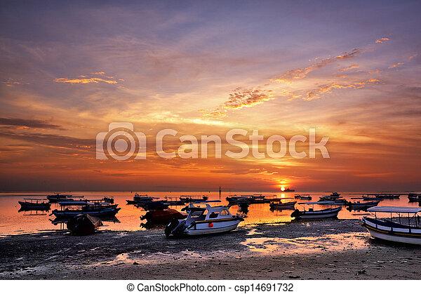 sunrise over fishing boats on Bali - csp14691732