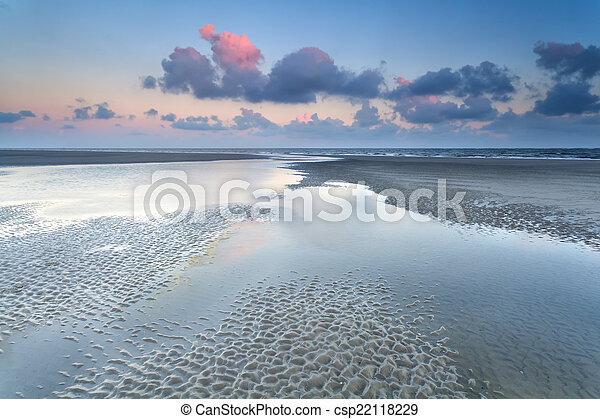 sunrise over North sea at low tide - csp22118229