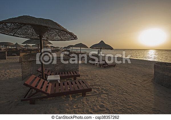 Sunrise over ocean on tropical resort beach - csp38357262