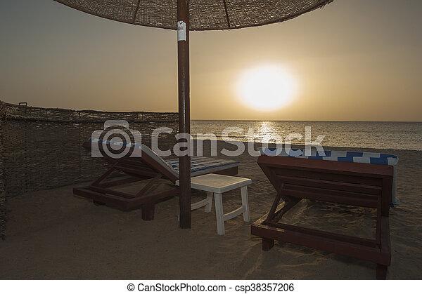 Sunrise over ocean on tropical resort beach - csp38357206