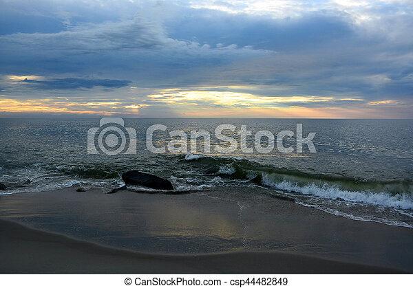 Sunrise Over Rock Jetty - csp44482849