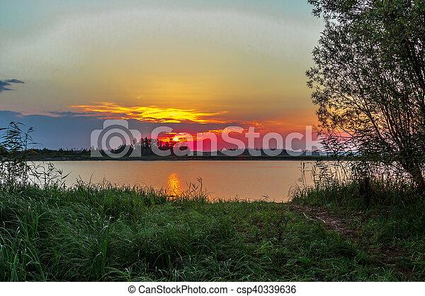 Sunrise over the lake - csp40339636
