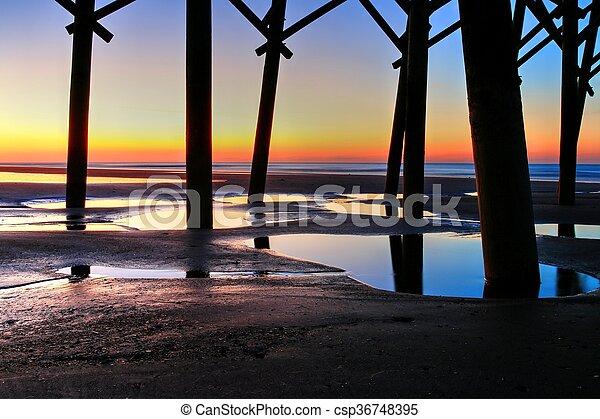 Sunrise Under Folly Pier - csp36748395