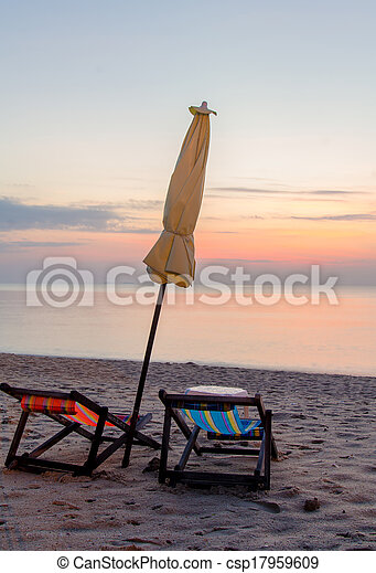 Sunrise under parasol on the beach - csp17959609