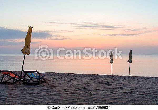 Sunrise under parasol on the beach - csp17959637