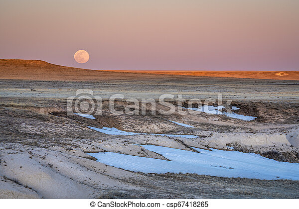 Sunset and moon rise over prairie - csp67418265