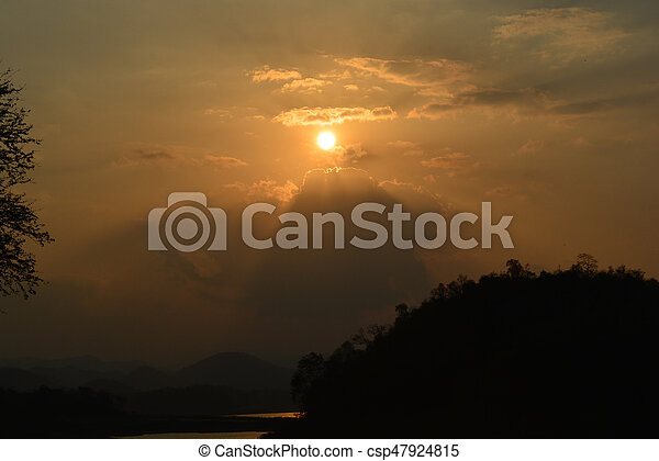 Sunset and silhouette mountain - csp47924815