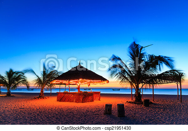 Sunset at a bar in a resort - csp21951430