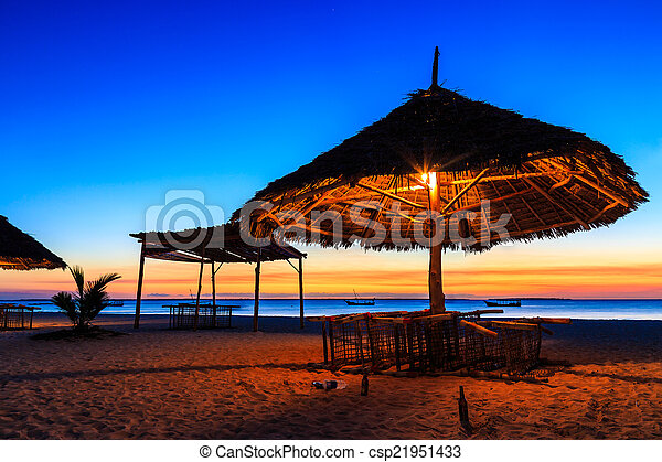 Sunset at a tropical resort - csp21951433