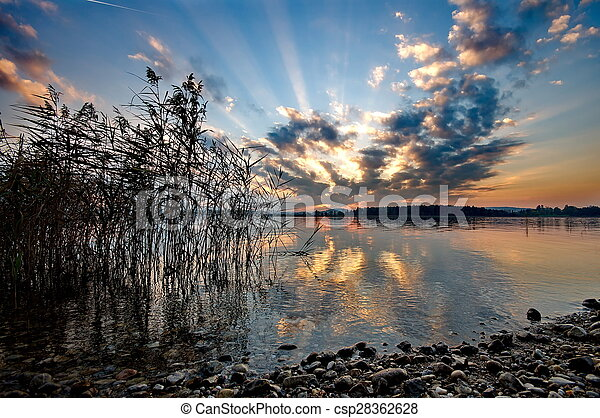 Sunset at lake Chiemsee in Germany - csp28362628