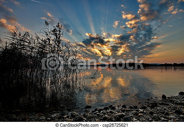 Sunset at lake Chiemsee in Germany - csp28725621