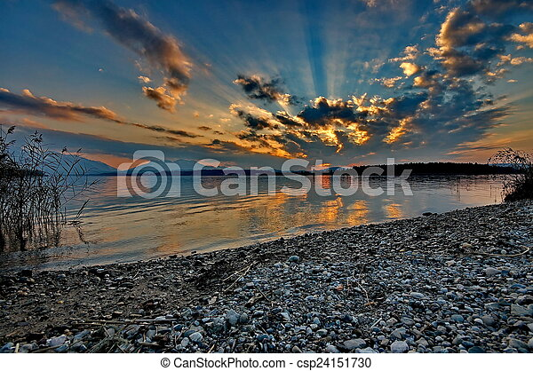 Sunset at lake Chiemsee in Germany - csp24151730