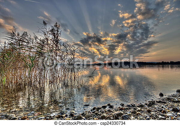 Sunset at lake Chiemsee in Germany - csp24330734