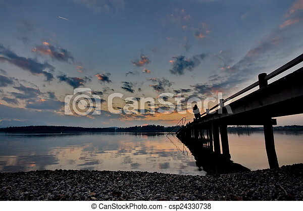 Sunset at lake Chiemsee in Germany - csp24330738